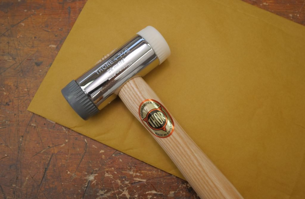 Chisel hammer on the workbench