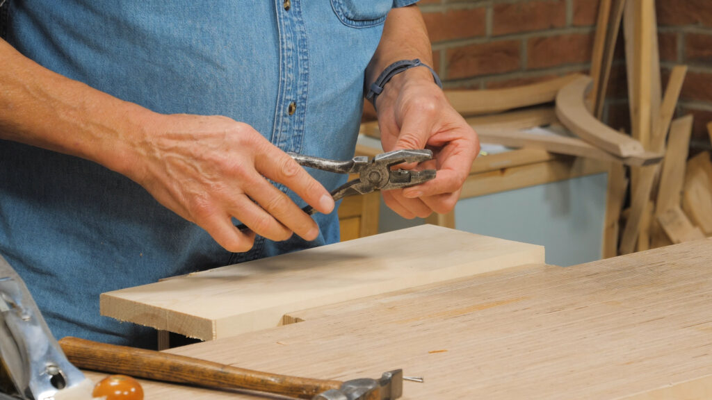 3. Using a nail in a drill as a pilot hole [1.47]
