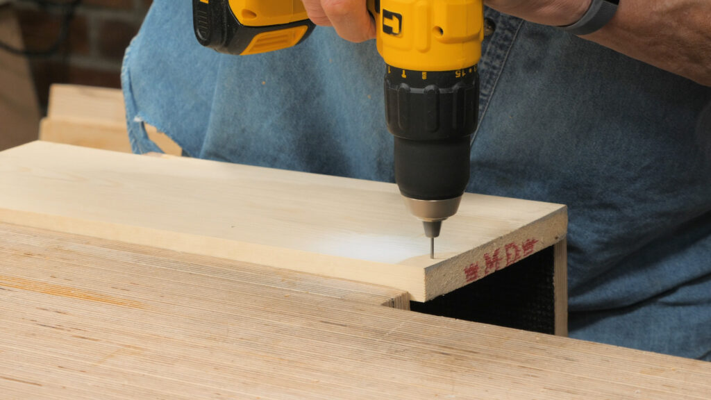 3. Using a nail in a drill as a pilot hole [2.02]