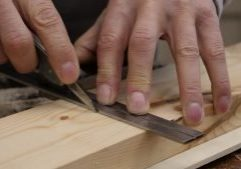 Use your non- dominant hand to hold the beam across your wood with one or two fingers on the stock to hold it in position.